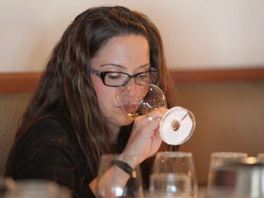 Noelle Waite, of Southern Wine & Spirits, drinks a white wine at The Arizona Republic Wine Competition at Tarbell's in Phoenix,  Arizona on October 26, 2015. (Photo by Ben Margiott/The Republic)