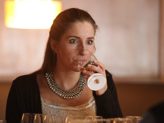 Sarah Joubert, supervisor at Westin Province, prepares to sip a white wine at The Arizona Republic Wine Competition at Tarbell's in Phoenix,  Arizona on October 26, 2015. (Photo by Ben Margiott/The Republic)
