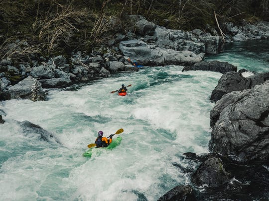 Kayakers take on the Green Wall rapid on Southern Oregon's Illinois River.
