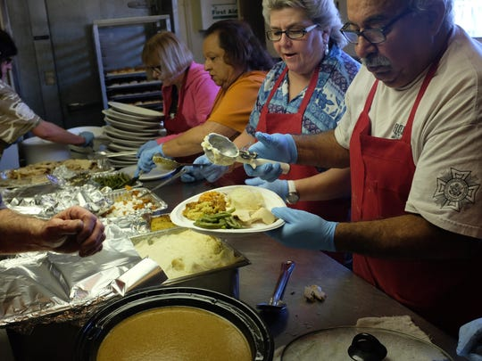 Thanksgiving meals come out hot and ready from the kitchen at American Legion Post 31 in Salinas on Thursday.