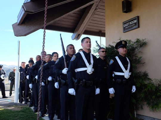 New officers wait outside Cypress Church on Thursday before the Monterey Peninsula College Police Academy graduation ceremony.