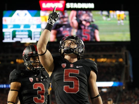 Dec 5, 2015; Santa Clara, CA, USA; Stanford Cardinal running back Christian McCaffrey (5) reacts after scoring a touchdown against the Southern California Trojans in the fourth quarter in the Pac-12 Conference football championship game at Levi's Stadium.  The Cardinal defeated the Trojans 41-22. Mandatory Credit: Cary Edmondson-USA TODAY Sports