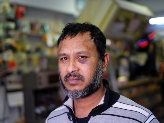 """Muslim shopkeeper Sarkar Haq, who was beaten in an alleged hate crime, speaks during an interview at his shop in New York on December 7, 2015. Muslim American leaders accused Republican Presidential hopeful Donald Trump of incitement for demanding a """"complete shutdown"""" of Muslims entering the US after a New York shopkeeper was beaten in an alleged hate crime. Trump's stunning statement followed last week's mass shooting in California by a Muslim couple believed to have been radicalized by extremists, and landed with a thunderclap just as fellow presidential candidates were contemplating ways to improve national security."""