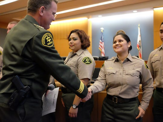 Sheriff Steve Bernal welcomes new deputies and deputy recruits at a ceremony in Salinas on Thursday.