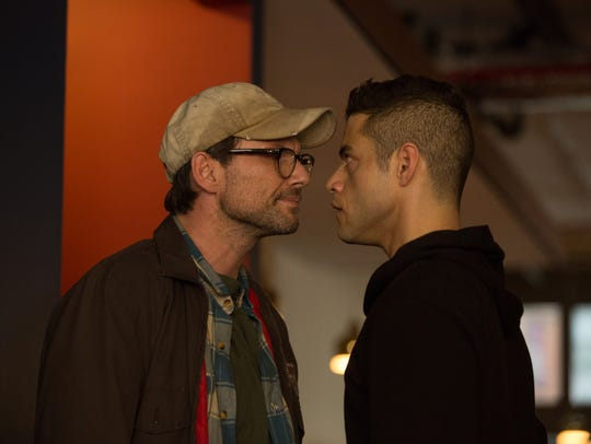 Christian Slater, left, as Mr. Robot faces off with