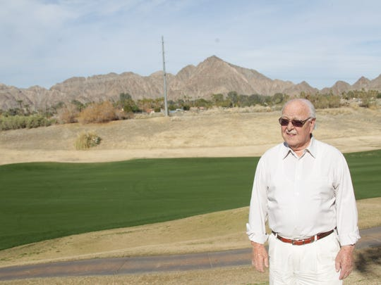 Warren Palmer is opposed to a proposal for a development on the corner of Avenue 50 Avenue and Washington Street in La Quinta. The property is visible in the distance from his backyard. The proposed development goes before the La Quinta Planning Commission Tuesday night.