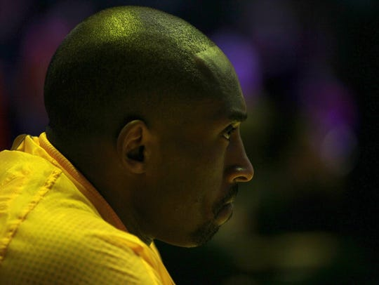 Kobe Bryant of the Los Angeles Lakers sits on the bench