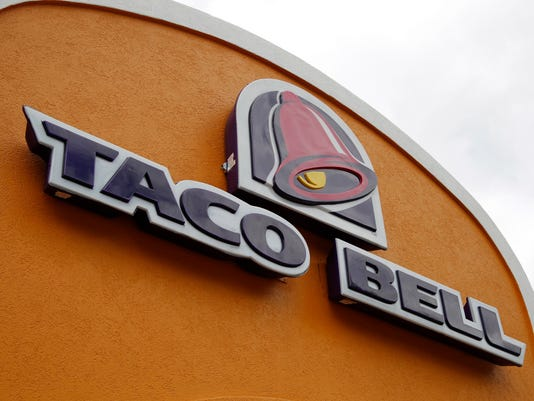 635944941871638475-taco-bell-AP-Earns-Yum-Brands-NYBZ207.jpg