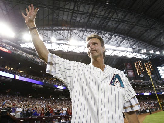 Arizona Diamondbacks' pitcher Randy Johnson waves to