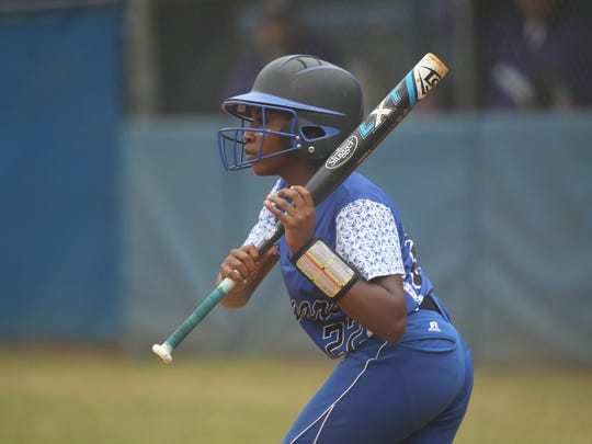 Godby's Tyra Brown prepares to lay down a bunt single as part of a two-run fourth inning for the Cougars in an 8-2 win over Marianna.