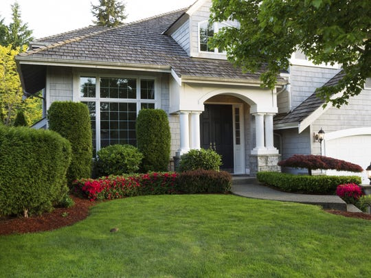 A well-maintained lawn can help sell a home.