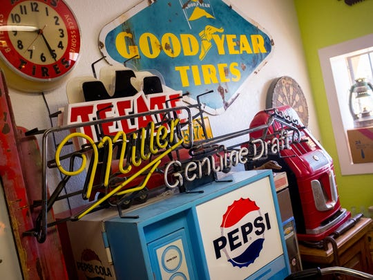 The Art Obscura gallery and collectibles store is stuffed full with a wide variety of salvaged objects including old neon advertisements, pinball machines and signage.