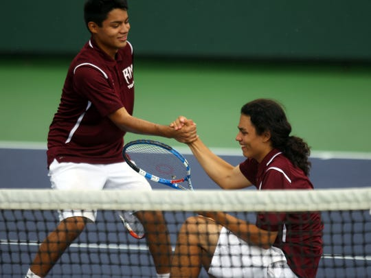 Rancho Mirage High's Luis Velazquez helps his partner Ivan Hernandez backup after a fall during their De Anza League semifinal match against 29 Palms on Friday, May 6, 2016 at the Indian Wells Tennis Garden in Indian Wells.