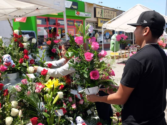 A family team from Decoraciones Bertha keeps the floral arrangements coming on Sunday, Mother's Day along E. Alisal St. in Salinas.