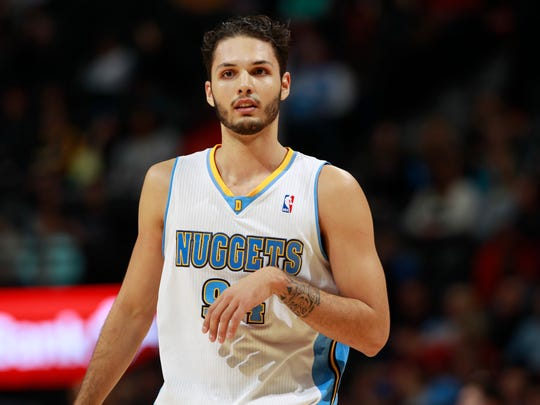 Denver Nuggets guard Evan Fournier looks on against the Orlando Magic in the fourth quarter of the Nuggets' 120-94 victory in an NBA basketball game in Denver on Saturday, Jan. 11, 2014.