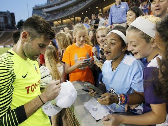 FC Cincinnati goalkeeper Mitch Hildebrandt signs autographs