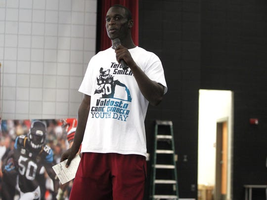 Former FSU football star Telvin Smith speaks to children at Lowndes High School during his Valdosta Game Changer Youth Day on Saturday.