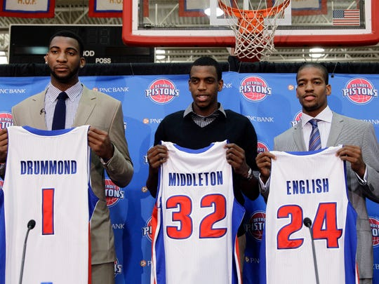 Detroit Pistons draft choices Andre Drummond (1), Khris Middleton (32) and Kim English (24) hold up jerseys while being introduced in Auburn Hills, Mich., Friday, June 29, 2012.