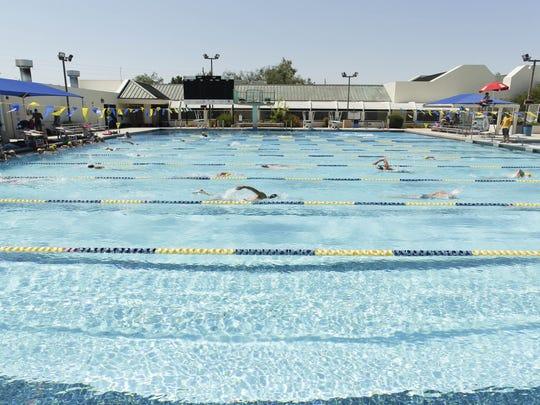 Members of the Scottsdale Aquatic Club swim practice