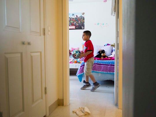 Sandra Godinez's son Ricardo Jr., 6, plays in their