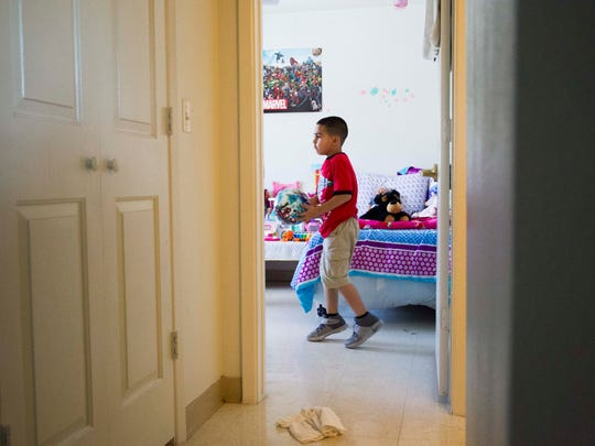 Sandra Godinez's son Ricardo Jr., 6, plays in their