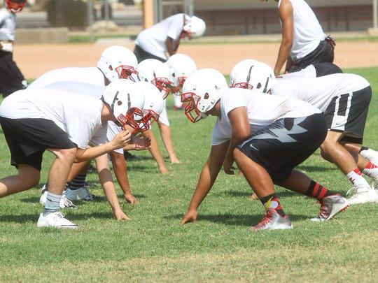 Palm Springs High School varsity football team practices