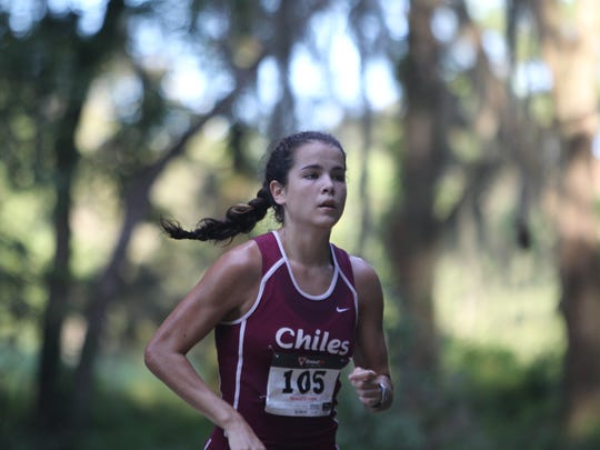 Chiles' Ana Wallace runs to the finish of the Cougar