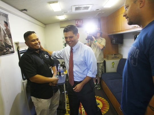 From left, Mark Ho, counselor for the Veteran Mobile Center, gives a tour of the mobile center to  Congressman Dr. Raul Ruiz during the presentation of a Veterans Mobile Center. The mobile center will visit the Coachella Valley in a biweekly basis including visiting the cities of Indio, Palm Desert and Palm Springs. At center is Elena Kim, field representative for the congressman.