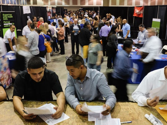 Browse different employers at the job fair held at The Rowan Hotel on August 22