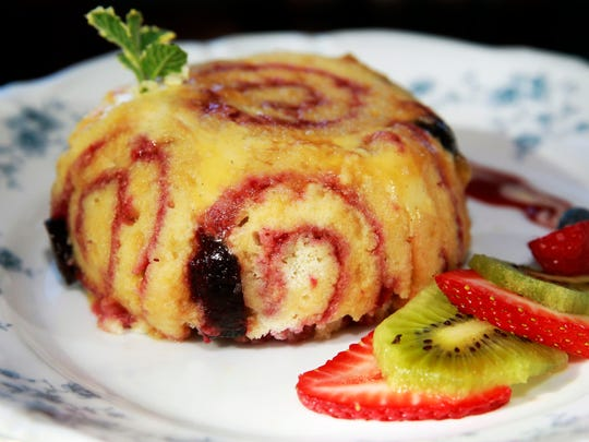 Charlotte Royal, a Belgian peach lambic, Bavarian cream and raspberry jelly roll dessert from Lagniappe Brasserie at 17001 W. Greenfield Ave., New Berlin.