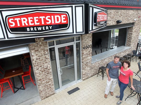 Brian and Kathie Hickey, two of the owners of Streetside Brewery, Columbia Tusculum, on the patio on the front of their establishment on Eastern Avenue.