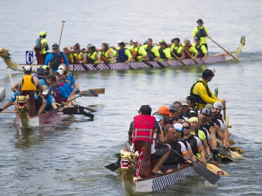 Competitors at the Dragon Boat Festival on Tempe Town Lake on Sunday, Oct. 2, 2016.