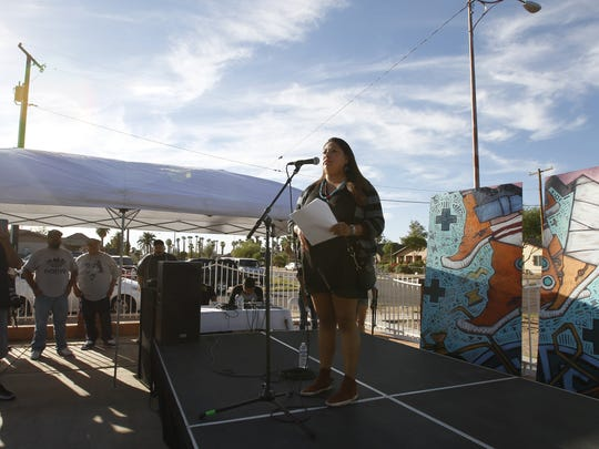 Talia White from Mesa Community College read various poems about resistance and Indigenous pride during the first celebration of Indigenous Peoples Day in Phoenix on Oct. 10, 2016.