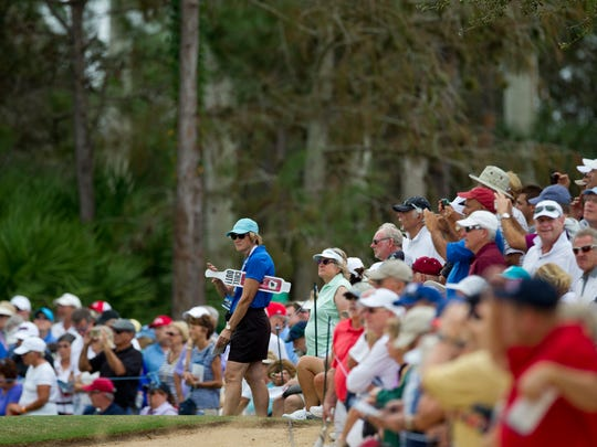 Spectators watch golfers work their way through the eighth hole at the Tiburon Golf Course in Naples on Saturday, Nov. 22, 2014, the third day of the LPGA's CME Group Tour Championship.