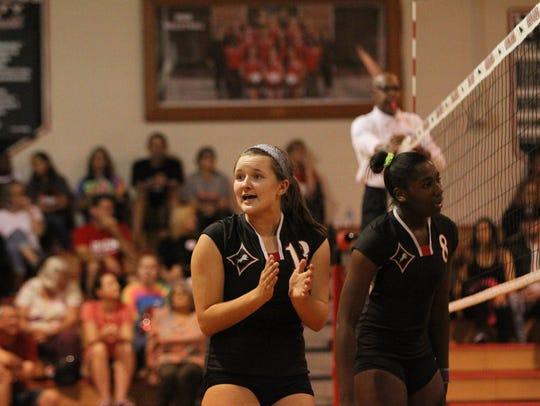 Leon's Jordyn Goracke encourages her team during a
