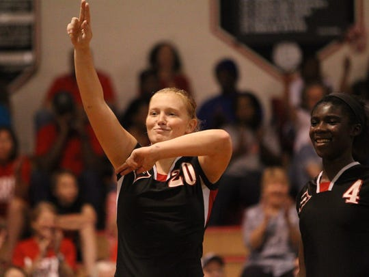 Leon's Kate Carter reacts after her team won a point during a playoff game against Niceville.