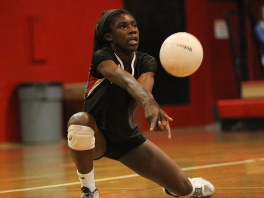 Leon's Shania Cromartie digs a ball during a playoff game against Niceville.
