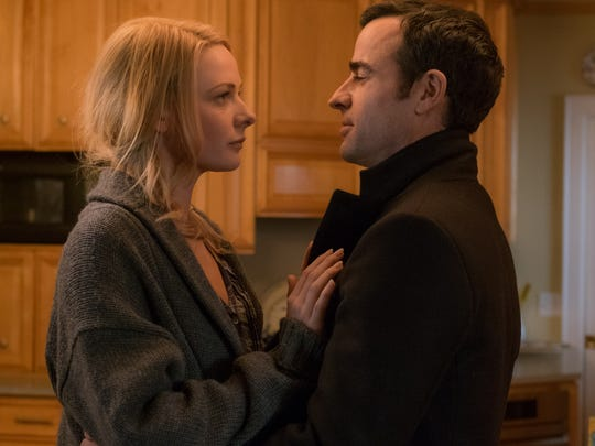 Justin Theroux and Rebecca Ferguson appear in a scene