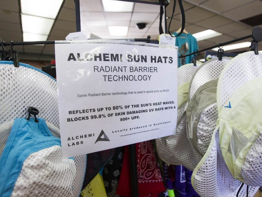 Alchemi Labs sun hats are displayed at Arizona Hiking Shack in Phoenix on Sept. 30, 2016. The hat's inventor, Andy Birutis, won a $50,000 grant for the company through Pfizer's Project Get Old for its use of radiant barriers in hats to reflect heat and UV light from the sun.