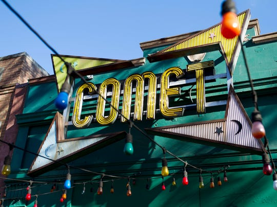 """The front door of Comet Ping Pong pizza shop, in Washington, Monday, Dec. 5, 2016. A fake news story prompted a man to fire a rifle inside a popular Washington, D.C., pizza place as he attempted to """"self-investigate"""" a conspiracy theory that Hillary Clinton was running a child sex ring from there, police said."""