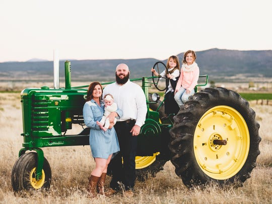 Kyle and Shelley Wilson, who operate a farm in Enterprise,