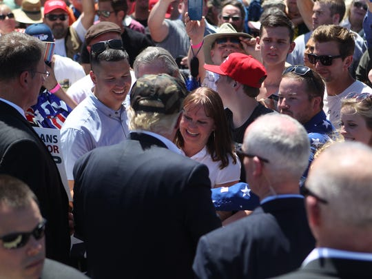 Presidential candidate Donald Trump works the crowd and speaks to Redding mayor Missy McArthur when he visited Redding in June, speaking to a crowd at Redding Municipal Airport.