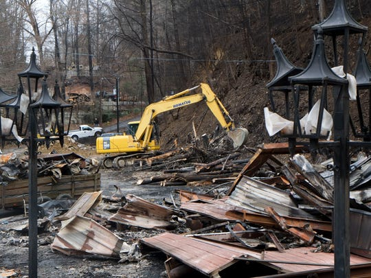 Clean up work is in progress at the ruins of Maples' Forge Tuesday, Dec. 20, 2016, in Gatlinburg. Blacksmith Roy J. Maples owned the building that was one of thousands destroyed in the wildfires that hit the city on Nov. 28. It housed a creative co-op called the Potter and the Park which his grandson, Tommy Bullen, managed.