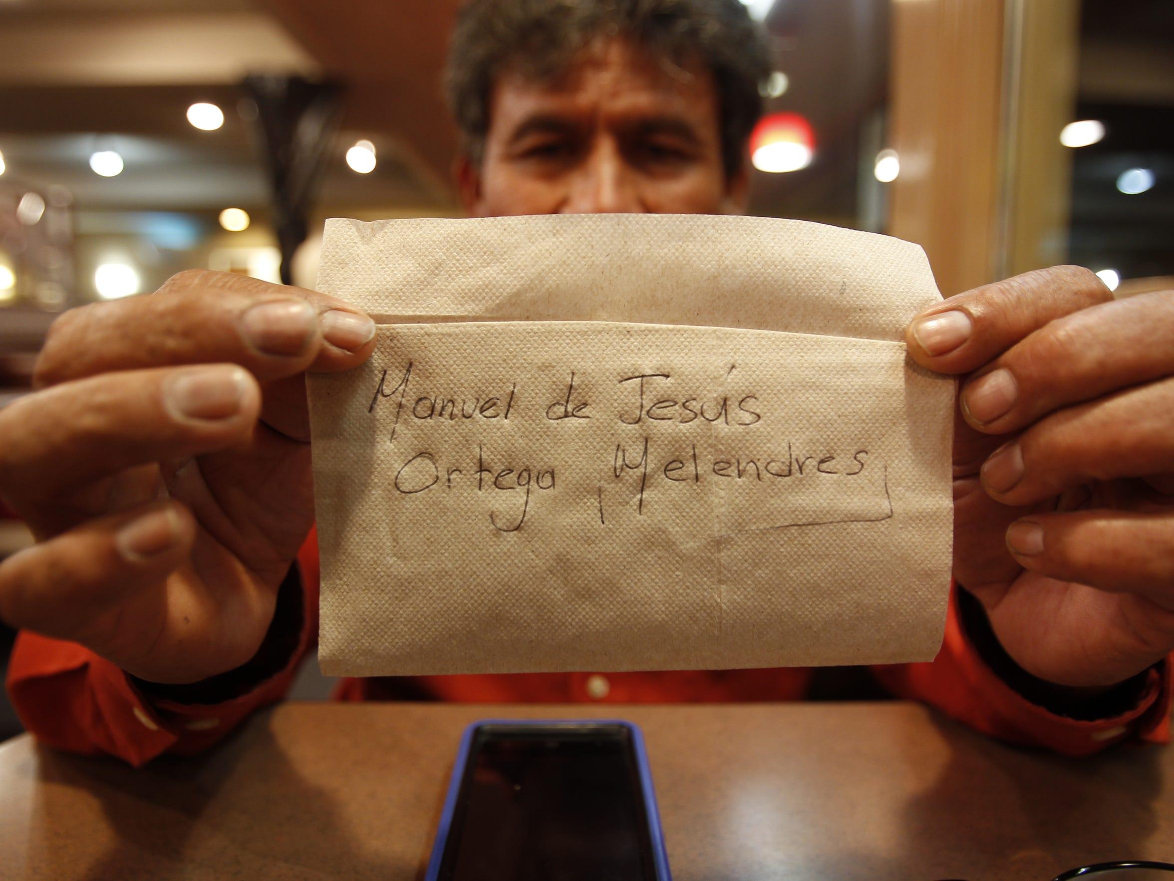 Manuel de Jesús Ortega Melendres holds up a napkin