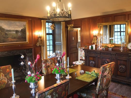 The east wing of Craiglen includes a first-floor walnut-paneled dining room with cedar marble floor and multi-marble fireplace.