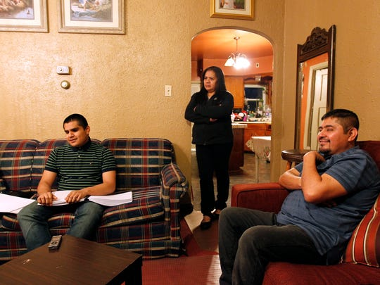 Carlos Garcia at home with his mother, Serinia, and father, Leon.