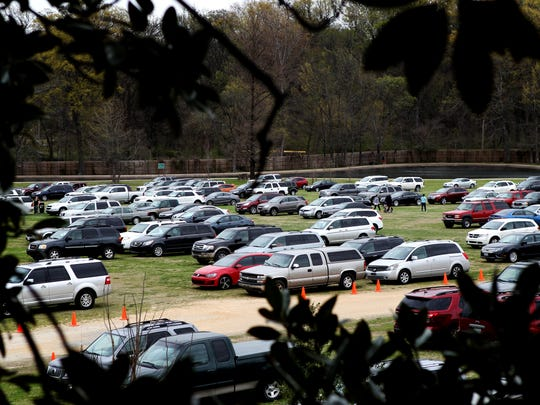 On a busy day, overflow parking for Memphis Zoo visitors spills onto the greensward at Overton Park.