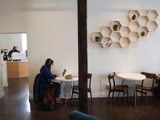 MaryAnne Carey enjoys the new Honeybee Coffee Company