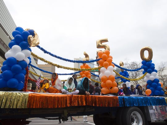 Members of Arizona's Sikh community march in a parade during festivities for Sikh Awareness and Identity Day in downtown Phoenix on Jan. 15, 2017.