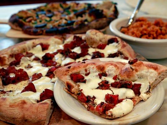A bruschetta pizza (front center) pesto chicken pizza (back center) and arroz con gandules were prepared by Synara Brown.